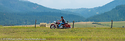 Riding alongside I-90 during the Sturgis Black Hills Motorcycle Rally. SD, USA. August 4, 2014.  Photography ©2014 Michael Lichter.