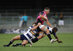 Johan Sadie and Siya Kolisi of the DHL Stormers tackles  PJ van Zyl of Boland during the final warm-up match before the start of the Super Rugby season between the DHL Stormers and the Boland Cavaliers held at DHL Newlands Stadium in Cape Town, South Africa on 12 February 2011. Photo by Jacques Rossouw/SPORTZPICS