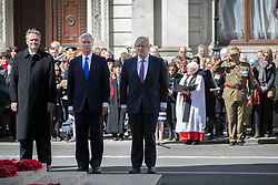 © Licensed to London News Pictures. 25/04/2017. London, UK. British Defence Sectretary Michael Fallon stands with Australian Finance Minister Mathias Cormann (L)  and British Foreign Secretary Boris Johnson during the ANZAC Day ceremony at the Cenotaph in Whitehall. A dawn ceremony and service was held at The Australian War Memorial and The New Zealand War Memorial at Hyde Park Corner.  April 25th is the day that Australia and New Zealand remember the dead of all wars. Photo credit: Peter Macdiarmid/LNP