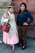 Bolivia 2013. La Paz. Norma Barrancos, journalist who wears traditional Aymara clothes and her sister, Leidy, school student, who wears fashionable urban clothing