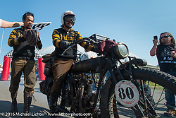 Yoshimasa Nimmi riding the team 80 1915 Indian Twin that he co-rides with Shinya Kimura crosses over the finish line with Shinya beside him at the end of Stage 16 (142 miles) of the Motorcycle Cannonball Cross-Country Endurance Run, which on this day ran from Yakima to Tacoma, WA, USA. Sunday, September 21, 2014.  Photography ©2014 Michael Lichter.