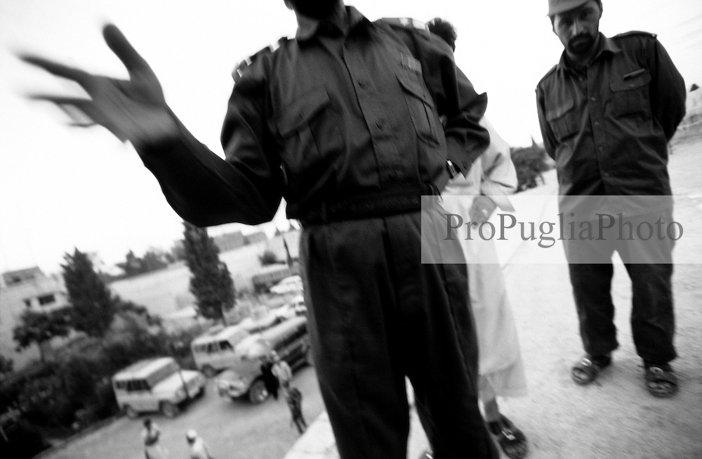 AFGHANISTAN, 10 AUGUST 2005..KHOST POLICE HEAD QUARTER..A Police officer, with an excellent command of Russian and German language, ask questions to a foreigner  who has been taken into custody for identification   ..