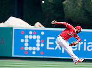 A leaping Gregorio Petit just misses this ball during the Angels' preseason game against the Chicago Cubs at Angel Stadium Sunday.<br /> <br /> <br /> ///ADDITIONAL INFO:   <br /> <br /> angels.0404.kjs  ---  Photo by KEVIN SULLIVAN / Orange County Register  --  4/3/16<br /> <br /> The Los Angeles Angels take on the Chicago Cubs at Angel Stadium during a preseason game at Angel Stadium Sunday.<br /> <br /> <br />  4/3/16