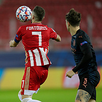 PIRAEUS, GREECE - NOVEMBER 25: Kostas Fortounis of Olympiacos FC and John Stones of Manchester City during the UEFA Champions League Group C stage match between Olympiacos FC and Manchester City at Karaiskakis Stadium on November 25, 2020 in Piraeus, Greece. (Photo by MB Media)