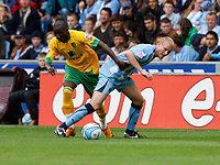 Photo: Richard Lane/Richard Lane Photography. Coventry City v Norwich City. Coca-Cola Championship. 09/08/2008. Norwich's Omar Koroma and Coventry's Robbie Simpson challenge for the ball.