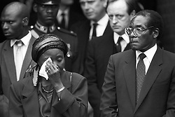 Robert Mugabe with his wife Sally at Lord Soames funeral at All Saints Curch, Odiham Lord Soames a former governor of Rhodesia, aided Mugabe in the early days of his country's independence.