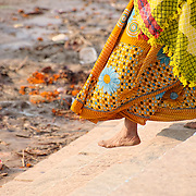 Woman walking Ganges for ceremonial bathing