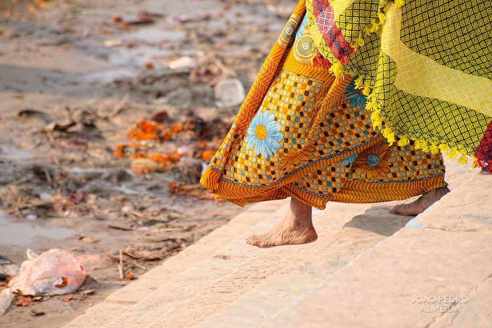 Woman walking Ganges for ceremonial bathing