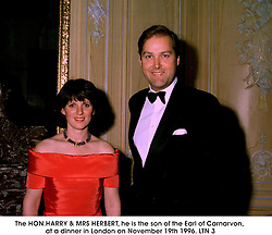 The HON.HARRY & MRS HERBERT, he is the son of the Earl of Carnarvon, at a dinner in London on November 19th 1996.LTN 3