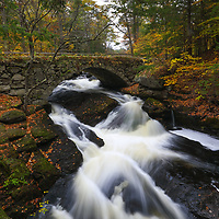 This fall I returned to New Hampshire for another exquisite waterfalls photography adventure. Gleason Falls with its cobble stone arch bridge and the wild Beard Brook made for a great outdoor photography subject. New England fall colors were still imminent, and I was able to frame the rushing brook and waterfall scene with them. An overcast sky beautifully balanced the light and New Hampshire scenery. <br />