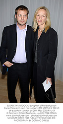 ELISABETH MURDOCH, daughter of Media tycoon Rupert Murdoch and her husband MR MATTHEW FREUD at a party in London on 28th May 2002.PAL 43