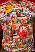 Glastonbury Festival, 2015.<br /> Man wearingT-shirt covered in variety of clown faces.