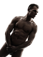 one  handsome naked muscular man standing portrait in silhouette studio on white background