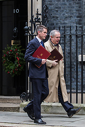 London, UK. 18th December, 2018. Gavin Williamson MP, Secretary of State for Defence, and Geoffrey Cox QC MP, Attorney General, leave 10 Downing Street following the final Cabinet meeting before the Christmas recess. Topics discussed were expected to have included preparations for a 'No Deal' Brexit.