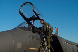Capt. Jesse Loya, 391st Fighter Squadron pilot, steps into an F-15E Strike Eagle during Green Flag West, June 13, 2018, at Nellis Air Force Base, Nevada. The 391st FS participated in Green Flag to further enhance readiness by training on Close Air Support over the National Training Center, Fort Irwin, California. (U.S. Air Force Photo by Airman 1st Class JaNae Capuno)