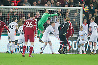 Football - 2017 / 2018 Premier League - Swansea City vs. Liverpool<br /> <br /> Lukasz Fabianski of Swansea City punches clear in the dying minute of the game, at The Liberty Stadium.<br /> <br /> COLORSPORT/WINSTON BYNORTH