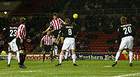Photo. Andrew Unwin.<br /> Sunderland v Rotherham, Coca-Cola Championship, Stadium of Light, Sunderland 22/02/2005.<br /> Sunderland's Gary Breen (C) heads home his team's third goal.