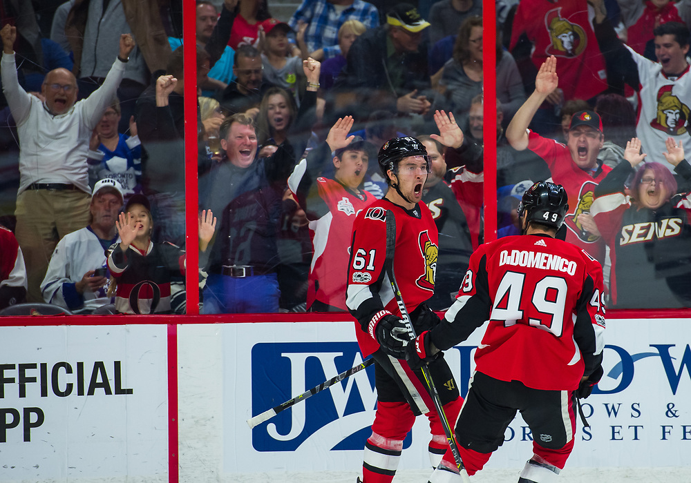 OTTAWA, ON - OCTOBER 21: Ottawa Senators Right Wing Mark Stone (61) celebrates his goal with Ottawa Senators Left Wing Christopher DiDomenico (49) during the NHL game between the Ottawa Senators and the Toronto Maple Leafs on Oct. 21, 2017 at the Canadian Tire Centre in Ottawa, Ontario, Canada. (Photo by Steven Kingsman/Icon Sportswire)