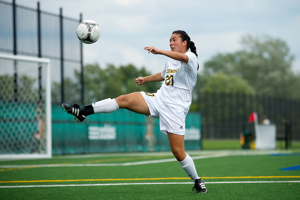 Vermont midfielder Midori Eckenstein (20) kicks the ball during the women's soccer game between the Brown Bears and the Vermont Catamounts at Virtue Field on Saturday afternoon September 8, 2012 in Burlington, Vermont.