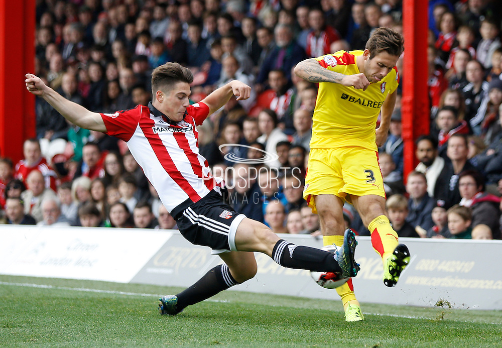 Brentford forward Sergi Canos gets a block in against Rotherham United defender (and former Brighton player) Joe Mattock to prevent a potentially dangerous cross in to  the box during the Sky Bet Championship match between Brentford and Rotherham United at Griffin Park, London, England on 17 October 2015. Photo by Andy Walter.