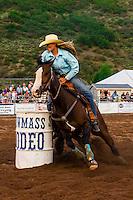 Barrel racing competition, Snowmass Rodeo, Snowmass Village (Aspen), Colorado USA.