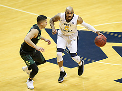 Jan 9, 2018; Morgantown, WV, USA; West Virginia Mountaineers guard Jevon Carter (2) dribbles during the first half against the Baylor Bears at WVU Coliseum. Mandatory Credit: Ben Queen-USA TODAY Sports