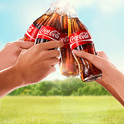 Hands raising four Coca-Cola bottle for a toast Ray Massey is an established, award winning, UK professional  photographer, shooting creative advertising and editorial images from his stunning studio in a converted church in Camden Town, London NW1. Ray Massey specialises in drinks and liquids, still life and hands, product, gymnastics, special effects (sfx) and location photography. He is particularly known for dynamic high speed action shots of pours, bubbles, splashes and explosions in beers, champagnes, sodas, cocktails and beverages of all descriptions, as well as perfumes, paint, ink, water – even ice! Ray Massey works throughout the world with advertising agencies, designers, design groups, PR companies and directly with clients. He regularly manages the entire creative process, including post-production composition, manipulation and retouching, working with his team of retouchers to produce final images ready for publication.