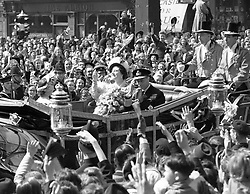 The scene at Ludgate Circus, London, as the King and Queen wave to well wishers as they make their way to St. Paul's Cathedral to celebrate their silver wedding anniversary.<br /><br />19480426