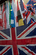 In the year that Britain will start the process of Brexit leaving the European Union, the flags of other nations above the crumpled British Union Jack flag in the window of a City retailer, on 2nd February 2017, in the City of London, England. In the y