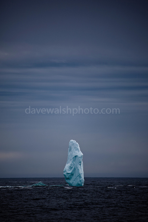 """Pinnacle of ice near the mouth of Kangerlugussuaq Fjord, East Greenland. The structure is part of a large iceberg, not pictured, worn away by wind and waves. This mage can be licensed via Millennium Images. Contact me for more details, or email mail@milim.com For prints, contact me, or click """"add to cart"""" to some standard print options."""