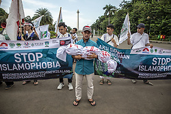 March 22, 2019 - Jakarta, Indonesia - Indonesian Youth Islam Movement Action (KAMMI) held demonstration at Jakarta. The demonstration is against the Mass Killing Action to Moslem People at two mosque in New Zealand which killed 50 muslims. They demand New Zealand Authority to give the hardest sentences to the killer and asking for death penalty, they also demanding to stop Islamphobia that were risen significantly in the western society in Europe, US, Australia. (Credit Image: © Donal Husni/ZUMA Wire)