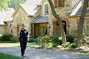 """Officer Brad Uptmore of the Southlake Police Department responds to a call in Southlake, Texas on June 23, 2017. """"CREDIT: Cooper Neill for The Wall Street Journal""""<br /> Police"""