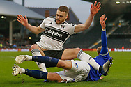 Oldham Athletic forward Sam Surridge (9) clatters into Fulham defender Calum Chambers (5) and calls for a second Oldham penalty during The FA Cup 3rd round match between Fulham and Oldham Athletic at Craven Cottage, London, England on 6 January 2019.