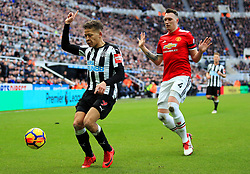 Dwight Gayle of Newcastle United and Phil Jones of Manchester United - Mandatory by-line: Matt McNulty/JMP - 11/02/2018 - FOOTBALL - St James Park - Newcastle upon Tyne, England - Newcastle United v Manchester United - Premier League