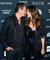 L-R: Rande Gerber and model Cindy Crawford attend the Harper's Bazaar Icons by Carine Roitfeld celebration at The Plaza Hotel in New York, NY on September 8, 2017.  (Photo by Stephen Smith/SIPA USA)