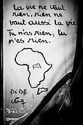 """A graffiti on the wall of the center shows a poem dedicated by one of its residents to his original country, Central African Republic with an illustration of the continent and the country: """" life is worthless, as nothing worth living, you have nothing, you are nothing"""" The walls of the center are like an improvised journal of the past and present residents. FEDASIL Sugny asylum center. Sugny, Belgium. July 2015. I took these photographs during an international volunteer program that I liderate with an international volunteering group."""