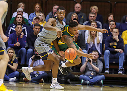 Mar 7, 2020; Morgantown, West Virginia, USA; West Virginia Mountaineers forward Oscar Tshiebwe (34) and Baylor Bears guard Mark Vital (11) dive for a loose ball during the second half at WVU Coliseum. Mandatory Credit: Ben Queen-USA TODAY Sports