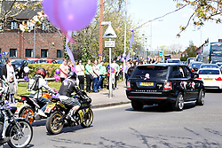 © Licensed to London News Pictures. 04/05/2016. Reading, UK. Funeral parade for a mother who died saving her daughters' life by pushing her pram out the way of an oncoming lorry in Reading, Berkshire. The community line the streets and have decorated lamposts and balloons in honour of Lauren Heath. The 20-year-old died at the scene of the crash in Basingstoke Road, Reading on Wednesday, April 13, when saving her baby girl, Millie. The service starts at St Agnes Church, Whitley and ends at Reading Crematorium in Caversham. Photo credit should read: Emma Sheppard/LNP