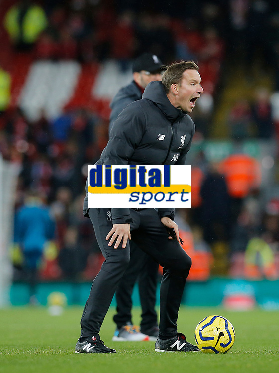 Football - 2019 / 2020 Premier League - Liverpool vs. Everton<br /> <br /> Liverpool assistant coach Pepijn Lijnders oversees the warm up as r Jurgen Klopp looks on before tonight's game, at Anfield.<br /> <br /> COLORSPORT/ALAN MARTIN