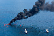 June 10, 2010 , Boats cleaning BP oil off the surface of the Gulf of Mexico by burning it.