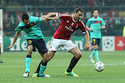 23.11.2011, Giuseppe Meazza Stadion, Mailand, ITA, UEFA CL, Gruppe H, AC Mailand (ITA) vs FC Barcelona (ESP), im Bild Zlatan Ibrahimovic Milan Sergio Busquets Barcellona // during the football match of UEFA Champions league, group H, between Gruppe H, AC Mailand (ITA) and FC Barcelona (ESP) at Giuseppe Meazza Stadium, Milan, Italy on 2011/11/23. EXPA Pictures © 2011, PhotoCredit: EXPA/ Insidefoto/ Paolo Nucci..***** ATTENTION - for AUT, SLO, CRO, SRB, SUI and SWE only *****