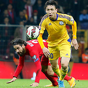 Turkey's Olcay Sahan (L) and Kazakhstan's Askhat Tagybergen (R) during their UEFA Euro 2016 qualification Group A soccer match Turkey betwen Kazakhstan at AliSamiYen Arena in Istanbul November 16, 2014. Photo by Kurtulus YILMAZ/TURKPIX