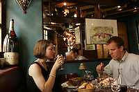 Todd Nielson and Laura Farmer, two Americans (financ?ed) in Paris, in a restaurant on Ile St. Louis.model released..photo by Owen Franken