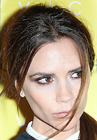 LONDON - FEBRUARY 17:  Fashion designer Victoria Beckham poses for cameras to toast her collection launch at Harvey Nichols, London, UK on February 17, 2012. (Photo by Richard Goldschmidt)