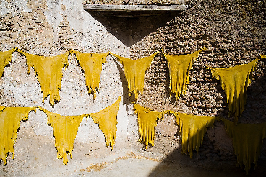 Sheep skins dyed bright yellow hang to dry on a wall in the Berber leather tannery in Fes El-Bali, Morocco, on October 31, 2007.