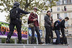 September 15, 2016 - Paris, France - French riot police push protestors on Place de la Republique during a demonstration against the controversial labour reforms of the French government in Paris on September 15, 2016...Opponents of France's controversial labour reforms took to the streets on September 15, 2016 for the 14th time in six months in a last-ditch bid to quash the measures that lost the Socialist government crucial support on the left. Scores of flights in and out of France were cancelled as air traffic controllers went on strike to try to force the government to repeal the changes that became law in July. GEOFFROY VAN DER HASSELT. (Credit Image: © Geoffroy Van Der Hasselt/NurPhoto via ZUMA Press)