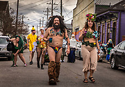 The Society of Saint Anne gathering to parade during Mardi Gras on 25th February 2020 in Bywater district of New Orleans, Louisiana, United States. Mardi Gras is the biggest celebration the city of New Orleans hosts every year. The magnificent, costumed, beaded and feathered party is laced with tradition and  having a good time. Celebrations are concentrated for about two weeks before and culminate on Fat Tuesday the day before Ash Wednesday and Lent. Wearing less clothing than considered decent in other contexts during Mardi Gras has been documented since 1889, when the Times-Democrat decried the degree of immodesty exhibited by nearly all female masqueraders seen on the streets. Risqué costumes, including body painting, is fairly common. Social scientists studying ritual disrobement found, at Mardi Gras 1991, 1,200 instances of body-baring in exchange for beads or other favours.