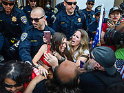 Heidi Muñoz Gleisner, left center, and Tara Thornton, right center, were removed from a demonstration in Sacramento on May 19, 2020.