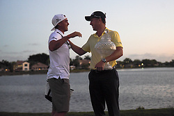 February 25, 2018 - Palm Beach Gardens, Florida, U.S. - Justin Thomas hugs last year's Honda Classic winner, Ricky Fowler, after the end of the final round of the 2018 Honda Classic at PGA National Resort and Spa in Palm Beach Gardens, Fla., on Sunday, February 25, 2018. (Credit Image: © Andres Leiva/The Palm Beach Post via ZUMA Wire)