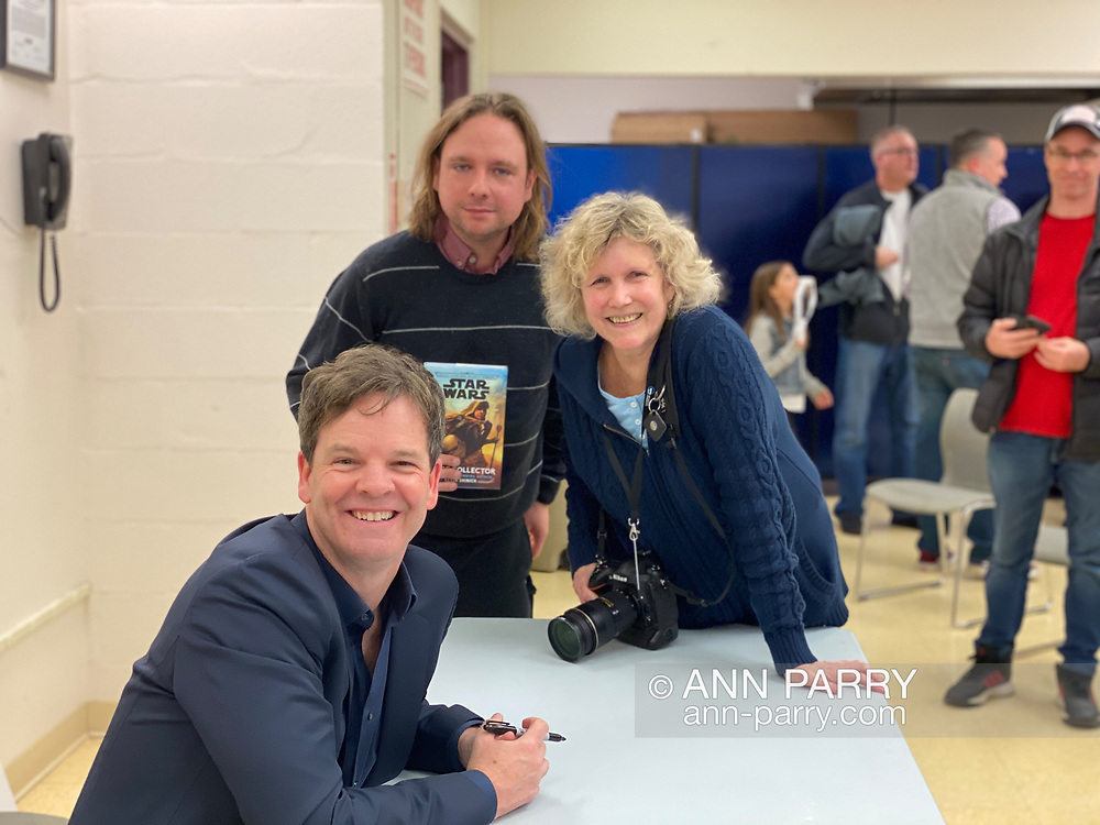 Merrick, NY, U.S. Dec. 20, 2019 L-R, Kevin Shinick, Chris Barron, and Ann Parry strike a pose at book signing for author Shinick's STAR WARS: FORCE COLLECTOR at North Merrick Library on Nassau County Force Collector Day. (© 2019 need photographer's name)